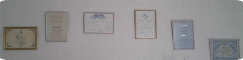 beauty treatement certificates on wall for Lorna London
